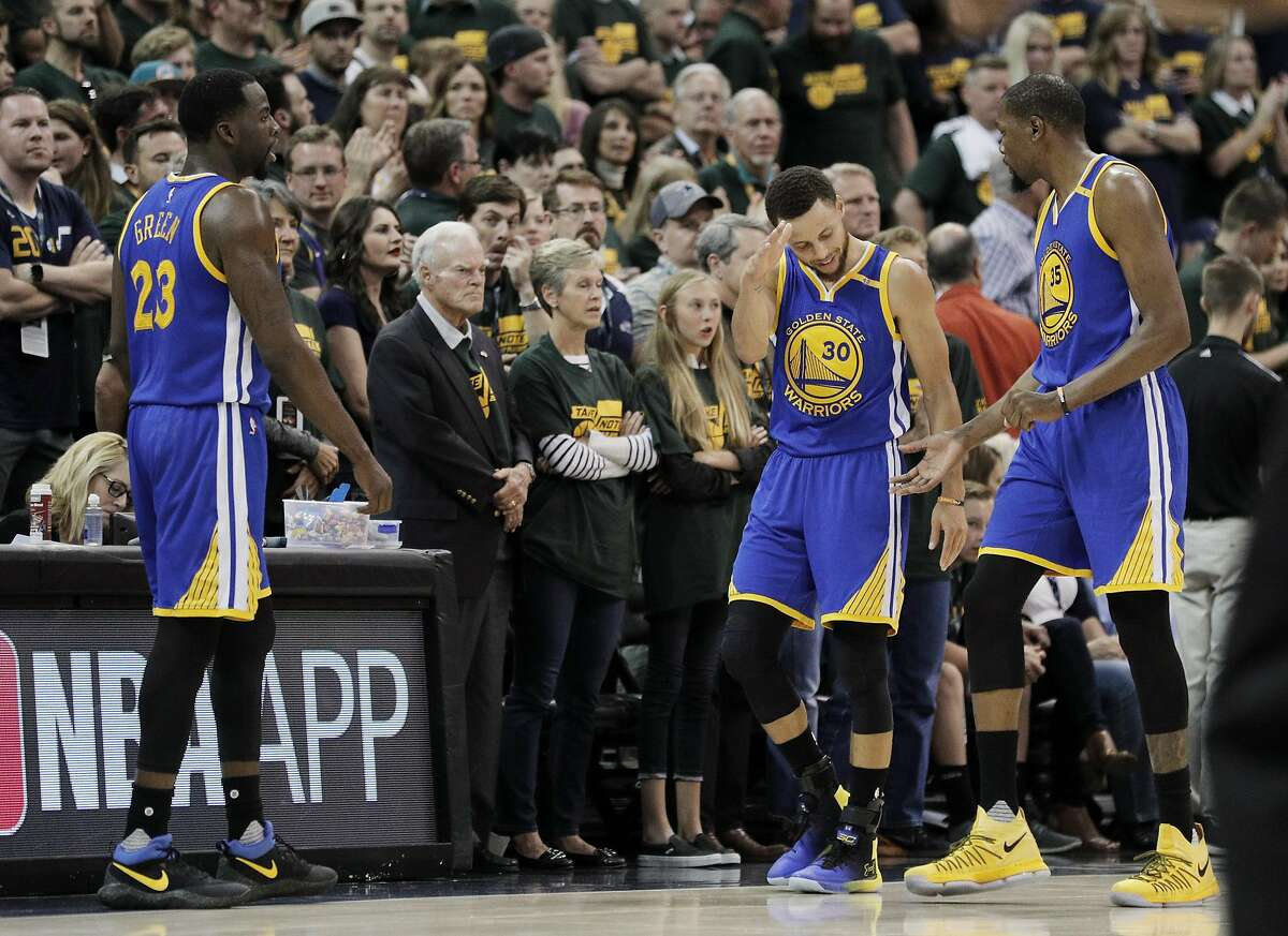 Stephen Curry (30) and Kevin Durant (35) celebrate in the closing minutes of the second half as the Golden State Warriors played the Utah Jazz at Vivint Smart Home Arena in Salt Lake City, Utah, on Saturday, May 6, 2017, in Game 3 of the 2017 Western Conference Semifinals.