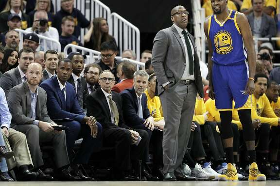 Warriors Acting Head Coach Mike Brown talks with Kevin Durant (35) in the second half as the Golden State Warriors played the Utah Jazz at Vivint Smart Home Arena in Salt Lake City, Utah, on Saturday, May 6, 2017, in Game 3 of the 2017 Western Conference Semifinals.