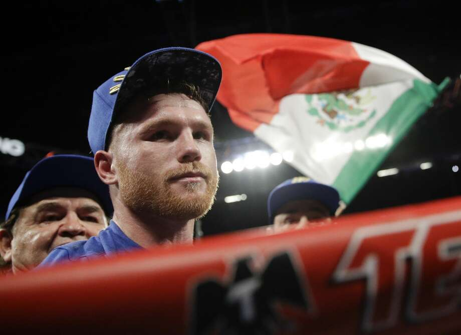 Canelo Alvarez, of Mexico, celebrates his win against Julio Cesar Chavez Jr., of Mexico, during their catch weight boxing match Saturday, May 6, 2017, in Las Vegas. (AP Photo/John Locher) Photo: John Locher/Associated Press