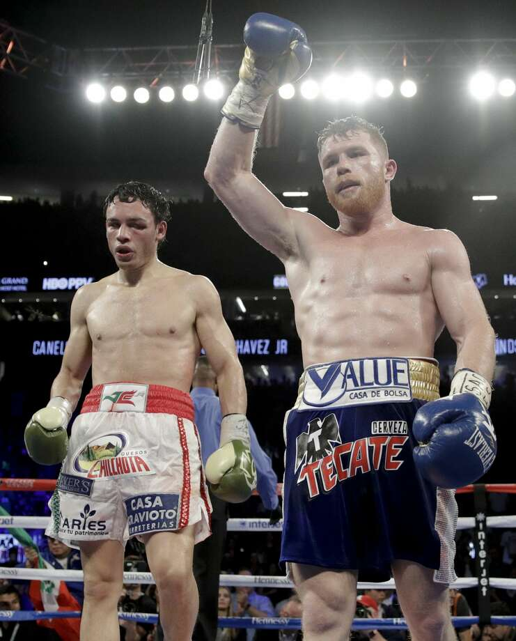 Canelo Alvarez, right, of Mexico, celebrates his win against Julio Cesar Chavez Jr., of Mexico, during their catch weight boxing match Saturday, May 6, 2017, in Las Vegas. (AP Photo/John Locher) Photo: John Locher/Associated Press