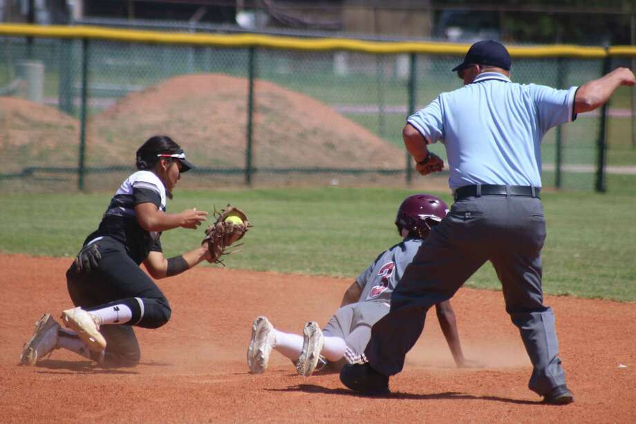 Memorial second baseman Maria Andrade makes the tag on Clear Creek's Pam Richardson during second-inning action Saturday.  Creek only got five girls into scoring position all day long. Photo: Robert Avery