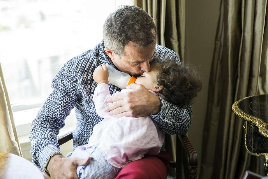 Jorge Maumer, a real estate developer and single gay dad, kisses son Augustine before nap time at their S.F. home. Photo: Stephen Lam, Special To The Chronicle