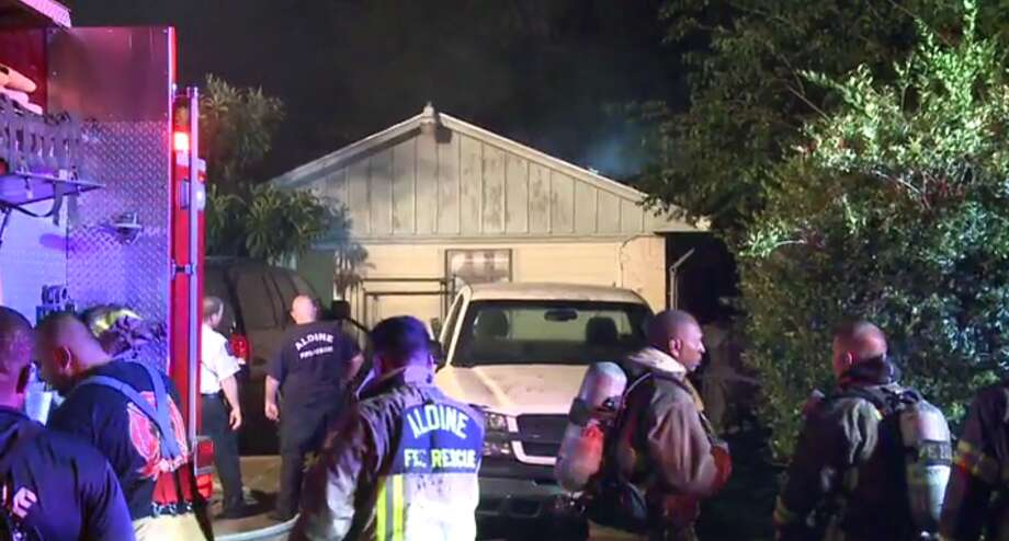 The fire burned through the roof of the house in Aldine. Photo: MetroVideo