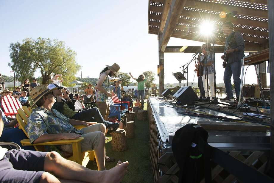 Above: Phil Lesh of the Grateful Dead performs at the casual Canal District venue he owns, Terrapin Crossroads, while the audience lounges in the sun. Photo: Erik Castro, Special To The Chronicle