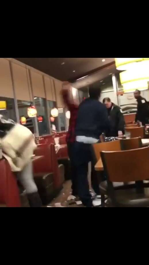 A screenshot taken from a video posted on Facebook showing a fight involving multiple people at the Wolf Road Denny's in Colonie early Sunday, May 7, 2017. Colonie police said there were no arrests. (Facebook)