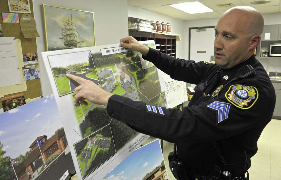 Sergeant Robert Durkin, of the Bethel Police Department, shows a rendering the new Bethel Police Station during an open house ahead of the referendum on the new station, in Bethel, Conn, on Wednesday night, December 3, 2014, Photo: H John Voorhees III / H John Voorhees III / The News-Times