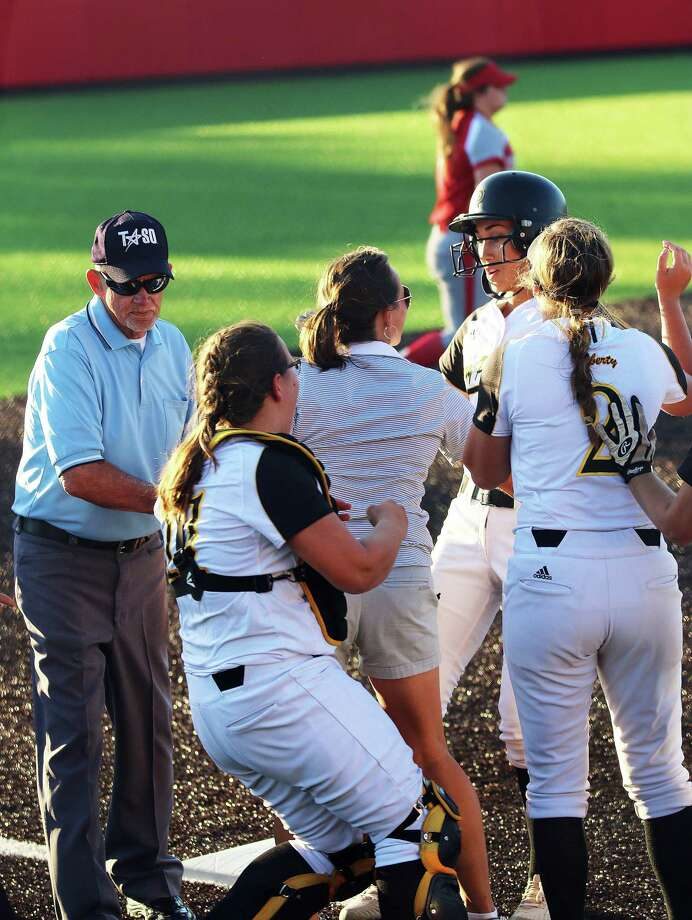 Harley Davis is swarmed by her teammates and coach at third base after the junior outfielder knocked in the winning run. The Lady Panthers won the first game against Bridge City, 4-3, but lost both games the following day. Photo: David Taylor