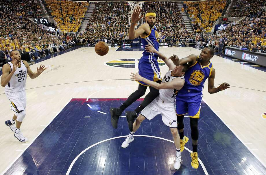 Joe Ingles (2) passes to Rudy Gobert (27) in the second half as he's defended by JaVale McGee (1) and Kevin Durant (35) as the Golden State Warriors played the Utah Jazz at Vivint Smart Home Arena in Salt Lake City, Utah, on Saturday, May 6, 2017, in Game 3 of the 2017 Western Conference Semifinals. The Warriors won the game 102-91 Photo: Carlos Avila Gonzalez, The Chronicle