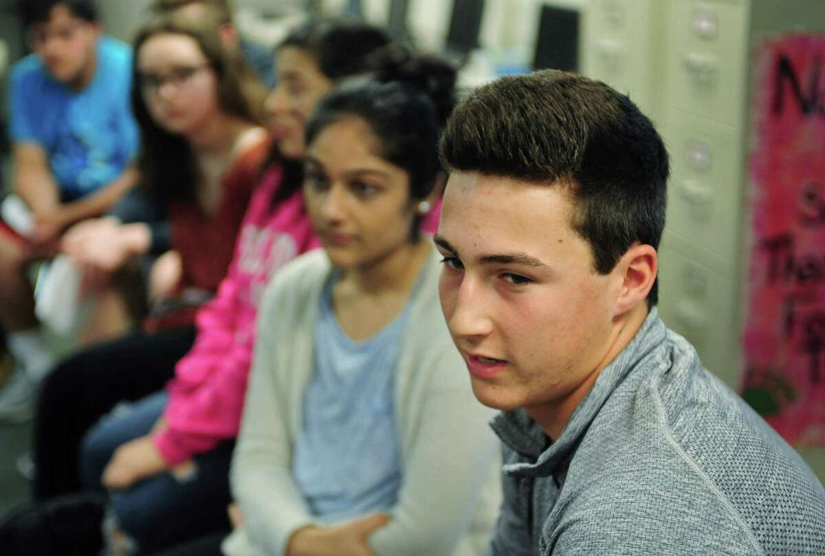 Norwalk High School seniors including Tommy Benincaso give their accounts on how their college application process went during a discussion in the career center at the school.