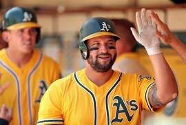 Oakland Athletics' Yonder Alonso returns to dugout after hitting a 2-run home run in 4th inning against Detroit Tigers during MLB game at Oakland Coliseum in Oakland, Calif., on Sunday, May 7, 2017.