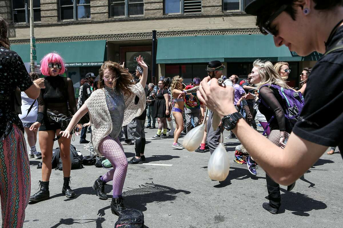 Ari Smith (center) dances at the 18th annual How Weird Street Faire on Sunday, May 6, 2017 in San Francisco, Calif.