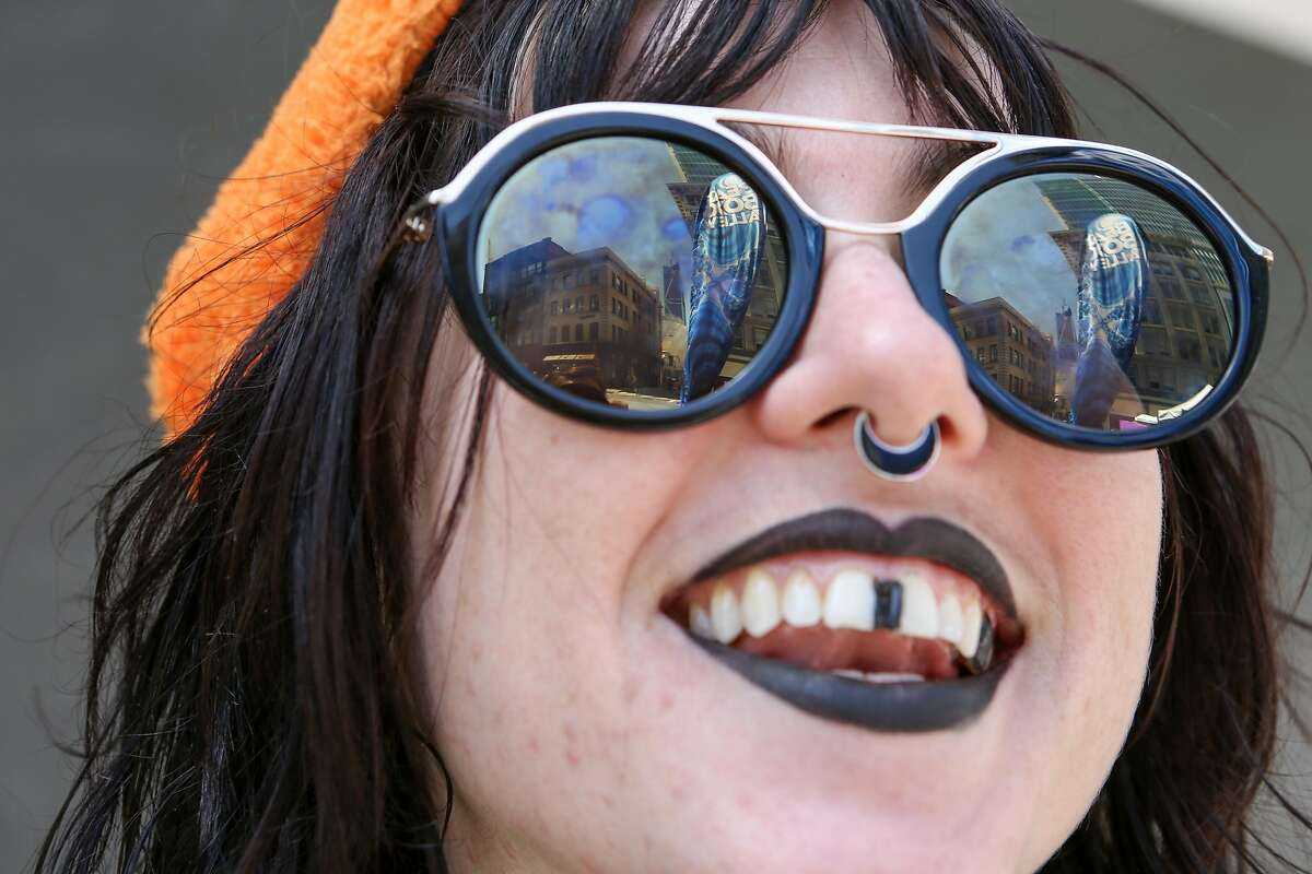 Riley Davidson shows off her teeth makeup at the 18th annual How Weird Street Faire on Sunday, May 6, 2017 in San Francisco, Calif.