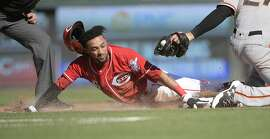 Cincinnati Reds' Billy Hamilton is caught stealing and tagged out by San Francisco Giants third baseman Connor Gillaspie during the fifth inning of a baseball game Sunday, May 7, 2017, in Cincinnati. (AP Photo/Michael E. Keating)