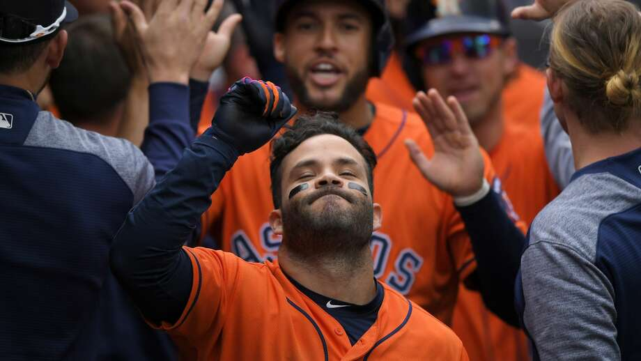 Houston Astros' Jose Altuve is congratulated by teammates after hitting a three-run home run during the third inning of a baseball game against the Los Angeles Angels, Sunday, May 7, 2017, in Anaheim, Calif. (AP Photo/Mark J. Terrill) Photo: Mark J. Terrill/Associated Press