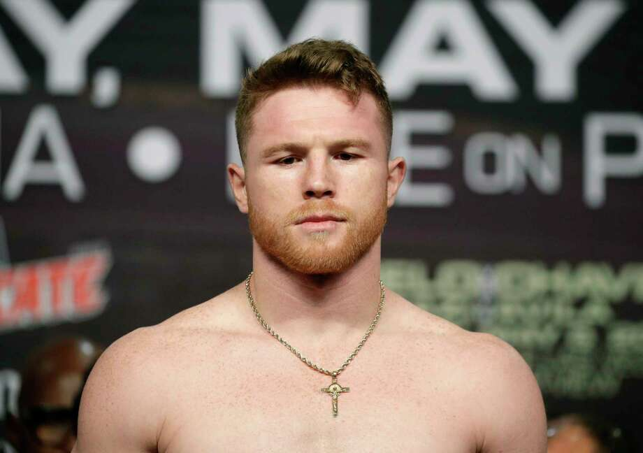 Canelo Alvarez stands on the scale during a weigh-in Friday, May 5, 2017, in Las Vegas. Alvarez is scheduled to fight Julio Cesar Chavez Jr. in a catch weight boxing match Saturday in Las Vegas. (AP Photo/John Locher) Photo: John Locher, STF / Copyright 2017 The Associated Press. All rights reserved.