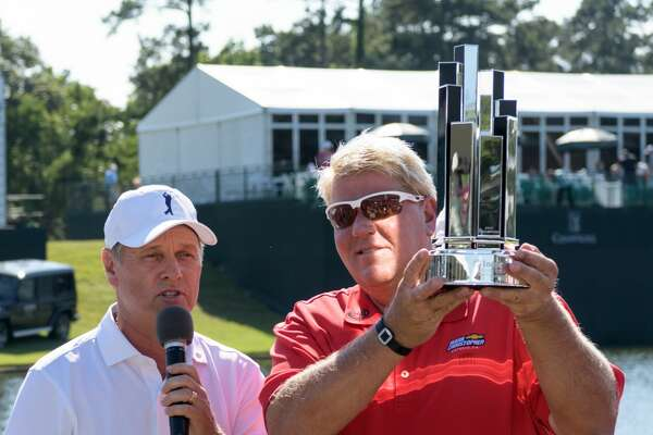 John Daly is presented the Trophy by Chairman and CEO of Insperity, Paul Sarvadi after winning the Insperity Invitational on Sunday, May 7, 2017 at The Woodlands Country Club Tournament Course in The Woodlands Texas.