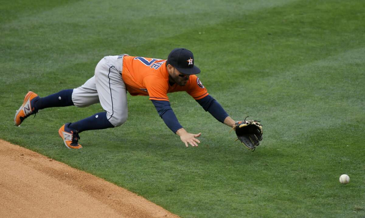 Houston Astros second baseman Jose Altuve can't reach a ball hit for s single by Los Angeles Angels' Luis Valbuena during the eighth inning of a baseball game, Sunday, May 7, 2017, in Anaheim, Calif. The Astros won 5-3. (AP Photo/Mark J. Terrill)