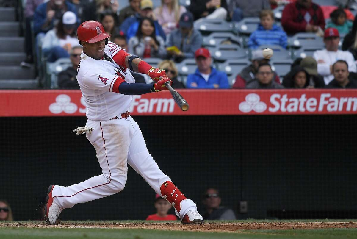 Los Angeles Angels third baseman Yunel Escobar hits a solo home run during the fifth inning of a baseball game against the Houston Astros, Sunday, May 7, 2017, in Anaheim, Calif. (AP Photo/Mark J. Terrill)
