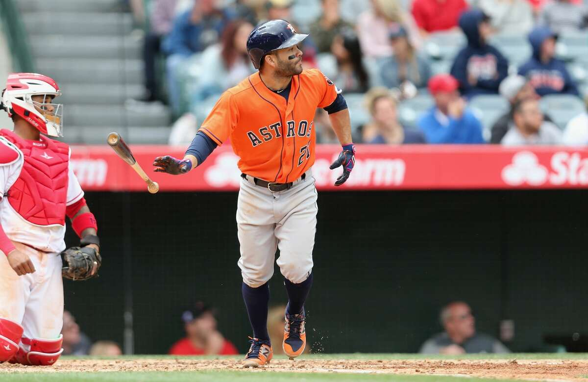 ANAHEIM, CALIFORNIA - MAY 07: Jose Altuve #27 of the Houston Astros tosses his bat as he watches his three run home run in the third inning against the Los Angeles Angels of Anaheim at Angel Stadium of Anaheim on May 7, 2017 in Anaheim, California. The Astros won 5-3. (Photo by Stephen Dunn/Getty Images)