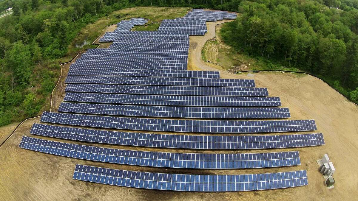 Above, a solar array developed by Clean Energy Collective in Rehoboth, Mass. Below, land at the Shelton transfer station that is being considered for a solar array.