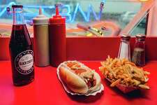 "Super Duper Weenie's New Yorker Hot Dog and fries in Fairfield. In the newly published 10th edition of ""Roadfood,"" first published in 1978, by Jane and Michael Stern, Super Duper Weenie has been elevated to the ""Roadfood"" honor roll of 100."