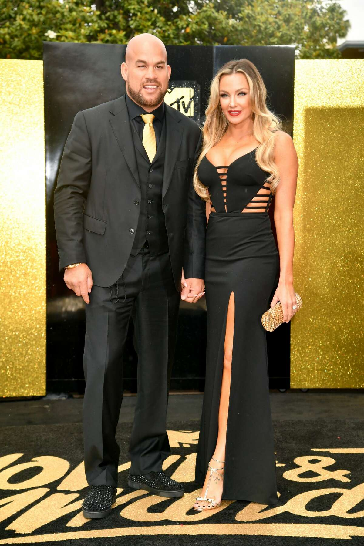 Worst: Tito Ortiz and Amber Nicole Miller know how to match in high school homecoming dance sort of way.
