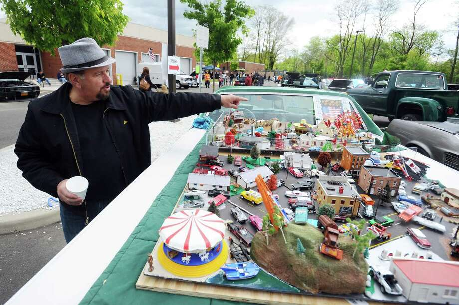 Jim Anderson, of Norwalk, shows off two dioramas on the back of his 1971 Chevy El Camino during the Car and Motorcycle Show hosted by J.M. Wright Technical School in the parking lot at the school in Stamford on Sunday. Photo: Michael Cummo / Hearst Connecticut Media / Stamford Advocate
