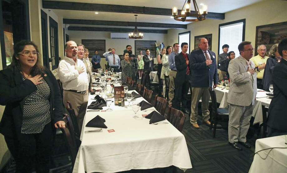 Elizabeth Amy Hernandez (left) leads the group in the Pledge of Allegiance as UIW College Republicans meet at Galpoa Gaucho Brazilian Steakhouse to celebrate their fromation on May 4, 2017. Photo: Tom Reel, Staff / San Antonio Express-News / 2017 SAN ANTONIO EXPRESS-NEWS