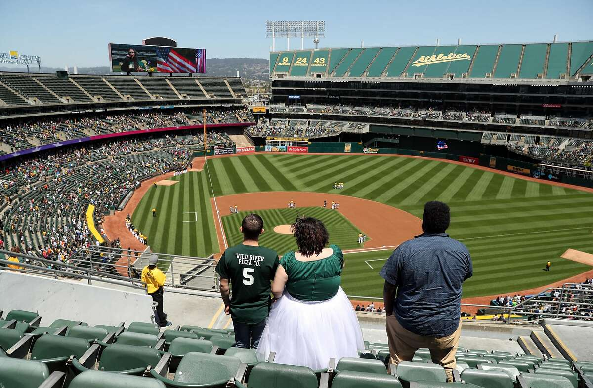 Oakland Athletics' fans stand during National Anthem before A's defeated the Detroit Tigers 8-6 during MLB game at Oakland Coliseum in Oakland, Calif., on Sunday, May 7, 2017.