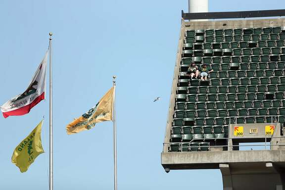 Oakland Athletics' fans enjoy the view from the upper deck during MLB game against Detroit Tigers at Oakland Coliseum in Oakland, Calif., on Sunday, May 7, 2017.