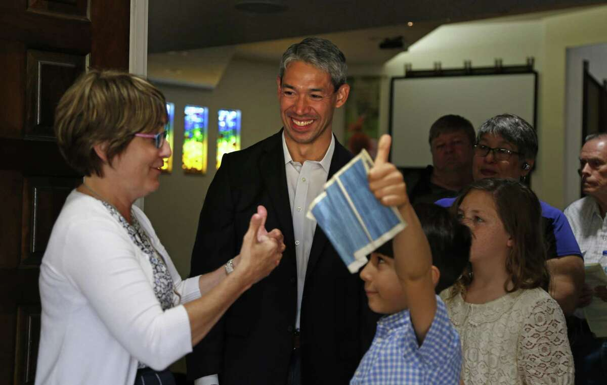 Ron Nirenberg listens as Rev. Diana Phillips, lead pastor at Colonial Hills United Methodist Church talks with his son Jayden,8, and niece Jayden,10 on Sunday, May 7, 2017.