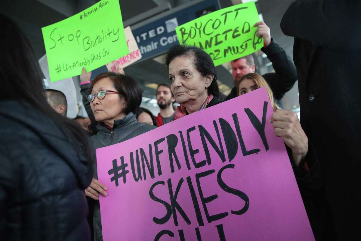 CHICAGO, IL - APRIL 11: Demonstrators protest outside the United Airlines terminal at O'Hare International Airport on April 11, 2017 in Chicago, Illinois. United Airlines has been struggling to restore their corporate image after a cell phone video was released showing a passenger being dragged from his seat and bloodied by airport police after he refused to leave a reportedly overbooked flight. (Photo by Scott Olson/Getty Images) ORG XMIT: 700033479
