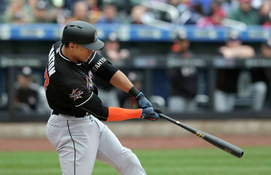 Miami Marlins' Giancarlo Stanton hits a three-run homer during the first inning of the baseball game against the New York Mets at Citi Field, Sunday, May 7, 2017, in New York. (AP Photo/Seth Wenig) ORG XMIT: NYSW101 Photo: Seth Wenig / Copyright 2017 The Associated Press. All rights reserved.