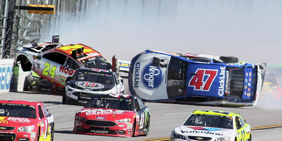 Chase Elliott (24) get airborne as AJ Allmendinger (47) flips on the backstretch in a crash involving multiple drivers bringing out a red flag during the Camping World 500 auto race at Talladega Superspeedway, Sunday, May 7, 2017, in Talladega, Ala. (AP Photo/Greg McWilliams) ORG XMIT: ALBD108 Photo: Greg McWilliams / Associated Press