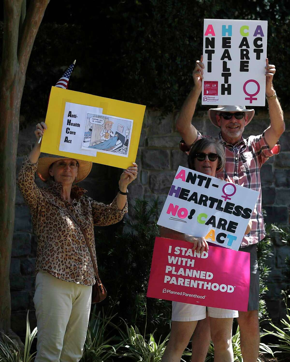 People protest against the AHCA outside of Representative John Culberson's office on Memorial Drive, Sunday, May , 2017, in Houston. ( Karen Warren / Houston Chronicle )