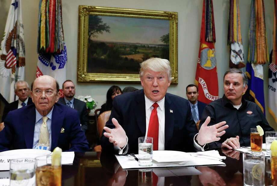 FILE - In this Feb. 2, 2017, file photo, President Donald Trump, flanked by then-Commerce Secretary-designate Wilbur Ross, left, and Harley Davidson President and CEO Matt Levatich, talks to media before a lunch meeting with Harley Davidson executives and union representatives in the Roosevelt Room of the White House in Washington. Trump says labor unions have an open door to his White House, but so far, he is holding it a little more ajar for some organizations than others. Trump has put out the welcome mat for the nation's construction trades, with whom he's had relationships during decades of building office towers and hotels. Also invited in have been auto, steel and coal workers who backed him during the 2016 election. But there's been no White House invitation for other unions representing the nation's sprawling _ but shrinking _ pool of 14.6 million workers who collectively bargain with employers in the labor movement. (AP Photo/Carolyn Kaster, File) ORG XMIT: WX101 Photo: Carolyn Kaster / Copyright 2017 The Associated Press. All rights reserved.