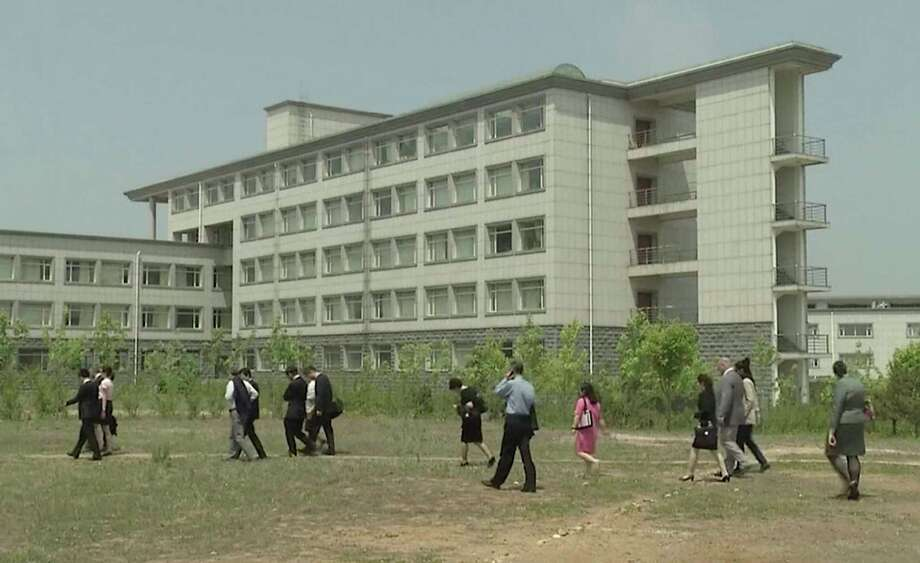 This image made from May 21, 2014, video shows a building at the Pyongyang University of Science and Technology. North Korea confirmed on Wednesday, May 3, 2017, the detention of American citizen Kim Sang Dok, who was referred to as  Kim Sang-duk when Pyongyang University of Science and Technology, where he was teaching accounting, previously announced his detention. Kim's English name is Tony Kim. (AP Photo) ORG XMIT: BKCD103 / APTN
