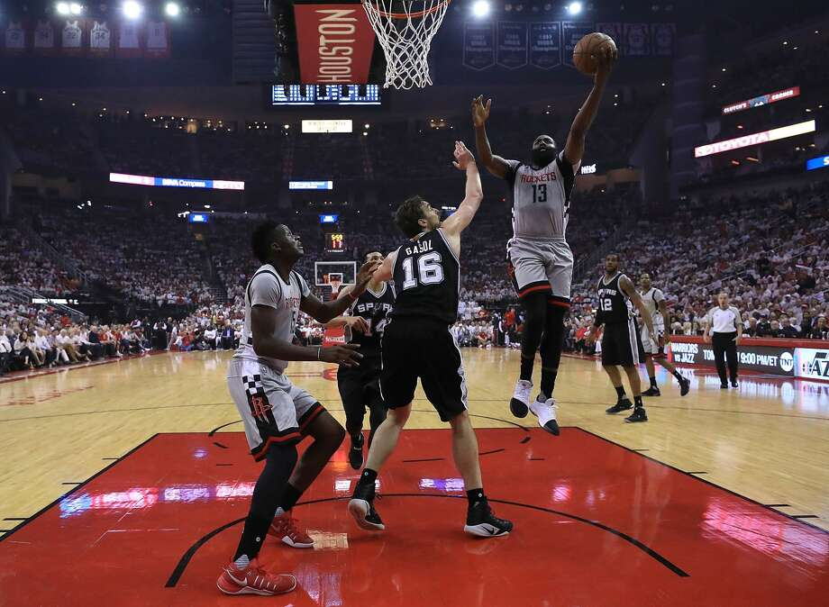 HOUSTON, TX - MAY 07:  James Harden #13 of the Houston Rockets attacks the basket against Pau Gasol #16 of the San Antonio Spurs during Game Three of the NBA Western Conference Semi-Finals at Toyota Center on May 7, 2017 in Houston, Texas.  NOTE TO USER: User expressly acknowledges and agrees that, by downloading and or using this photograph, User is consenting to the terms and conditions of the Getty Images License Agreement.  (Photo by Ronald Martinez/Getty Images) Photo: Ronald Martinez/Getty Images