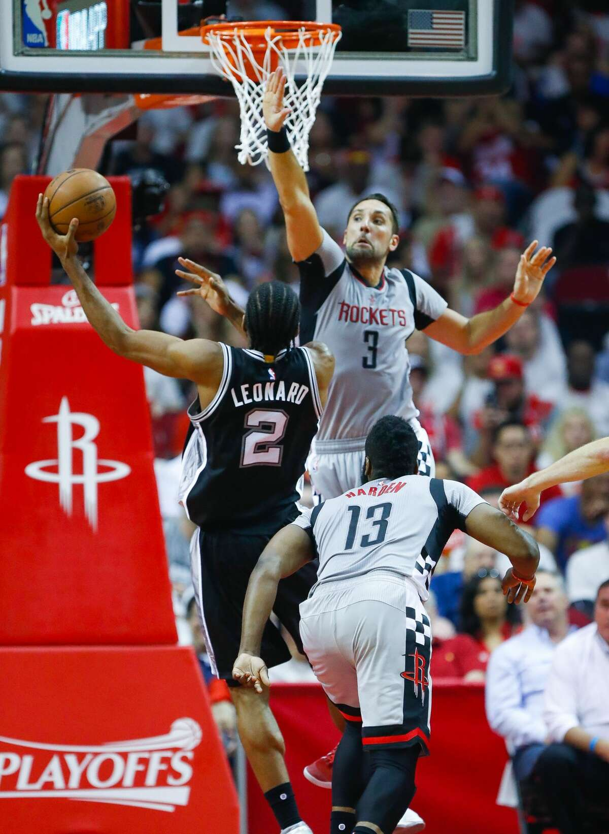 Houston Rockets forward Ryan Anderson (3) tries to stop a San Antonio Spurs forward Kawhi Leonard (2) shot during the first half of Game 3 of the second round of the Western Conference NBA playoffs at the Toyota Center, Sunday, May 7, 2017, in Houston. ( Karen Warren / Houston Chronicle )