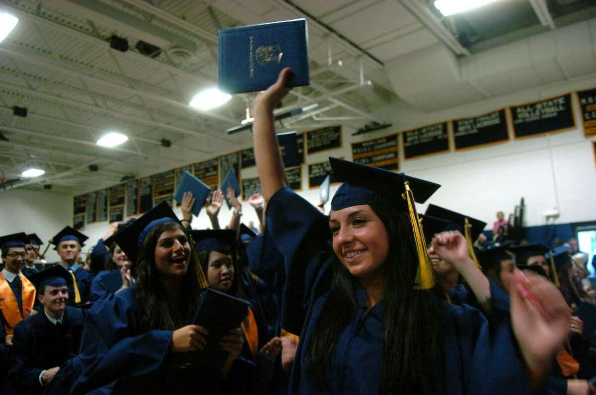 Alexandra Marie Razzino cheers with her classmates as they are presented to the audience, during Notre Dame of Fairfield's Class of 2010 Commencement Exercises in Fairfield, Conn. on Saturday June 05, 2010.