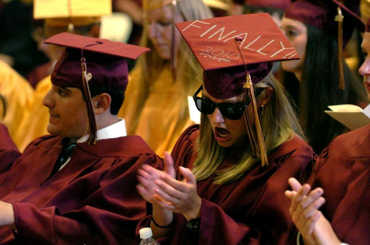 Christy Marie Babis cheers and claps, during St. Joseph's Class of 2010 Commencement Exercises in Trumbull, Conn. on Saturday June 05, 2010.