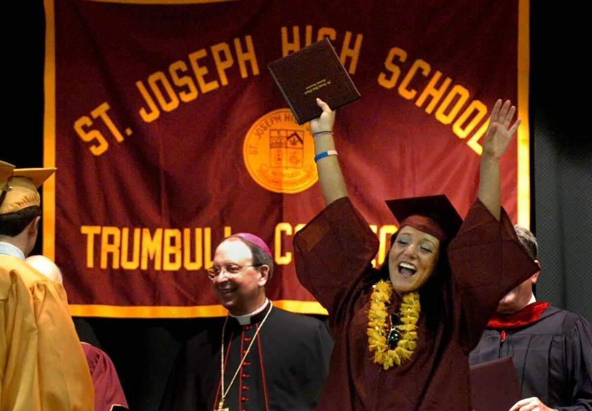 Alyssa Rose Cellini raises her arms and cheers after receiving her diploma, during St. Joseph's Class of 2010 Commencement Exercises in Trumbull, Conn. on Saturday June 05, 2010.