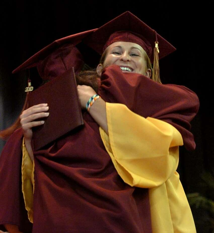Graduates Monica Hirschbeck, facing camera, and Rachel Heyse hug each other after getting their diplomas, during St. Joseph's Class of 2010 Commencement Exercises in Trumbull, Conn. on Saturday June 05, 2010.