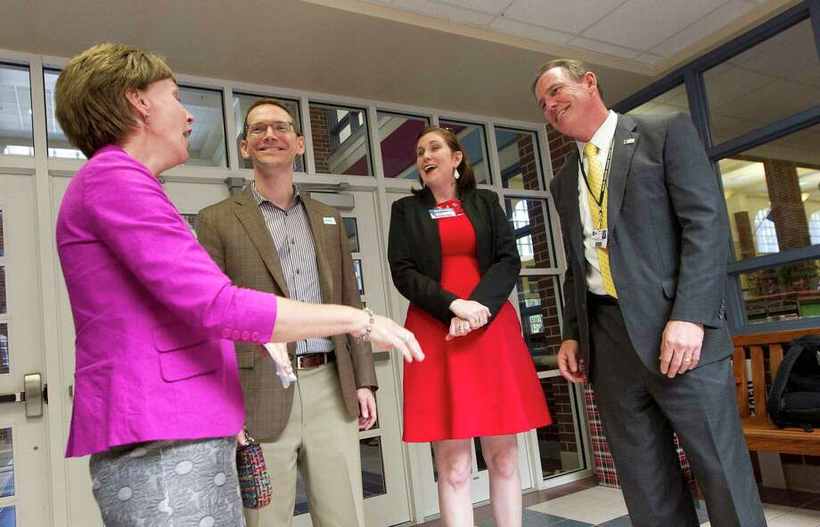Texas State Board of Education member Barbara Cargill, left, shares a laugh with Texas Commissioner of Education Mike Morath, second from left, along with Melanie Bush, Conroe ISD school board president, and Superintendent Don Stockton as Morath tours College Park High School, Thursday, in The Woodlands. Photo: Jason Fochtman, Staff Photographer / © 2017 Houston Chronicle