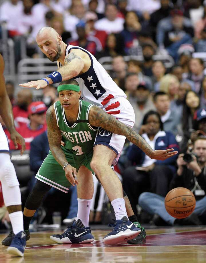 Boston Celtics guard Isaiah Thomas (4) passes the ball against Washington Wizards center Marcin Gortat (13), of Poland, during the first half in Game 4 of a second-round NBA basketball playoff series, Sunday, May 7, 2017, in Washington. (AP Photo/Nick Wass) ORG XMIT: VZN107 Photo: Nick Wass / FR67404 AP