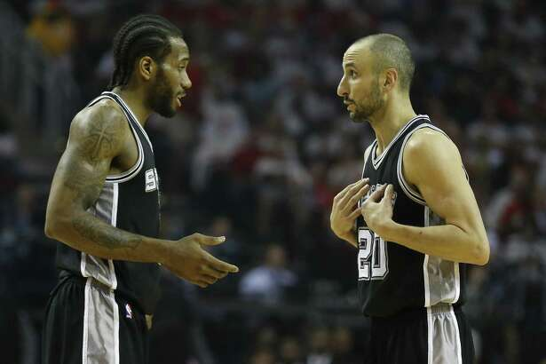 Kawhi Leonard and Manu Ginobili converse in last year's playoffs.
