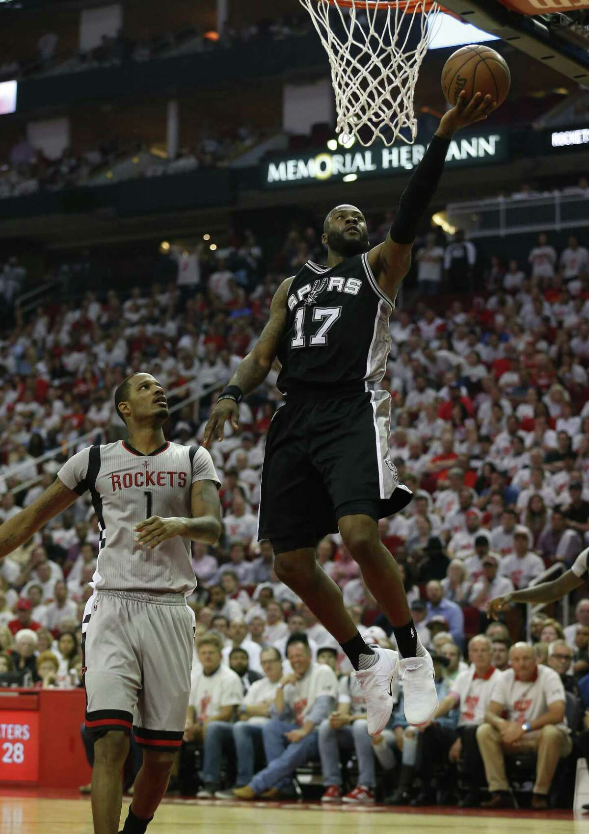 Spurs' Jonathon Simmons (17) scores against Houston Rockets' Trevor Ariza (01) in the second half of Game 4 of the Western Conference semifinals at the Toyota Center on Sunday, May 7, 2017. Rockets defeated the Spurs, 125-104, to even the series at 2-2. (Kin Man Hui/San Antonio Express-News)