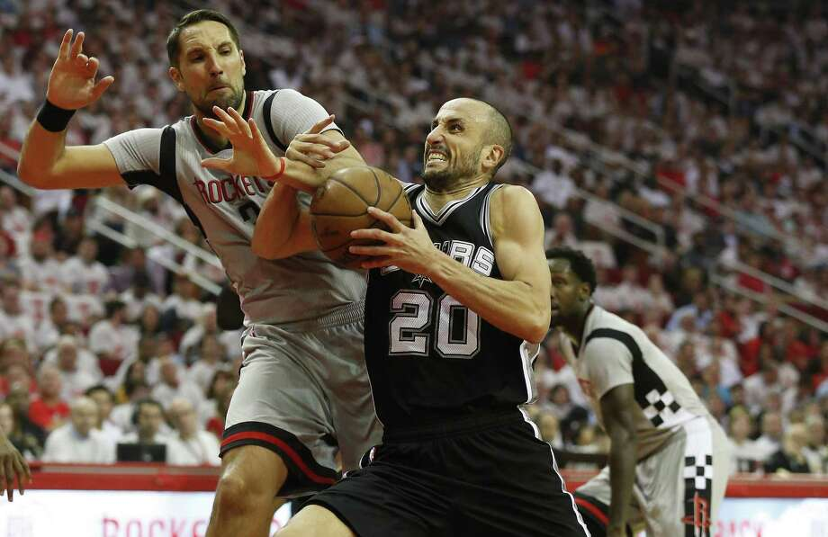 Spurs' Manu Ginobili drives the lane against the Rockets' Ryan Anderson in Game 4 at the Toyota Center on May 7, 2017. Photo: Kin Man Hui /San Antonio Express-News / ©2017 San Antonio Express-News