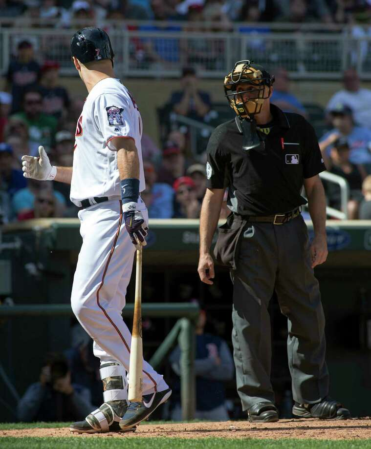 Minnesota Twins' Joe Mauer, left, has words with home plate umpire Dan Iassogna after being called out on strikes during the eighth inning of a baseball game against the Boston Red Sox, Sunday, May 7, 2017, in Minneapolis. (AP Photo/Paul Battaglia) ORG XMIT: MNPB10X Photo: Paul Battaglia / FR1768 AP