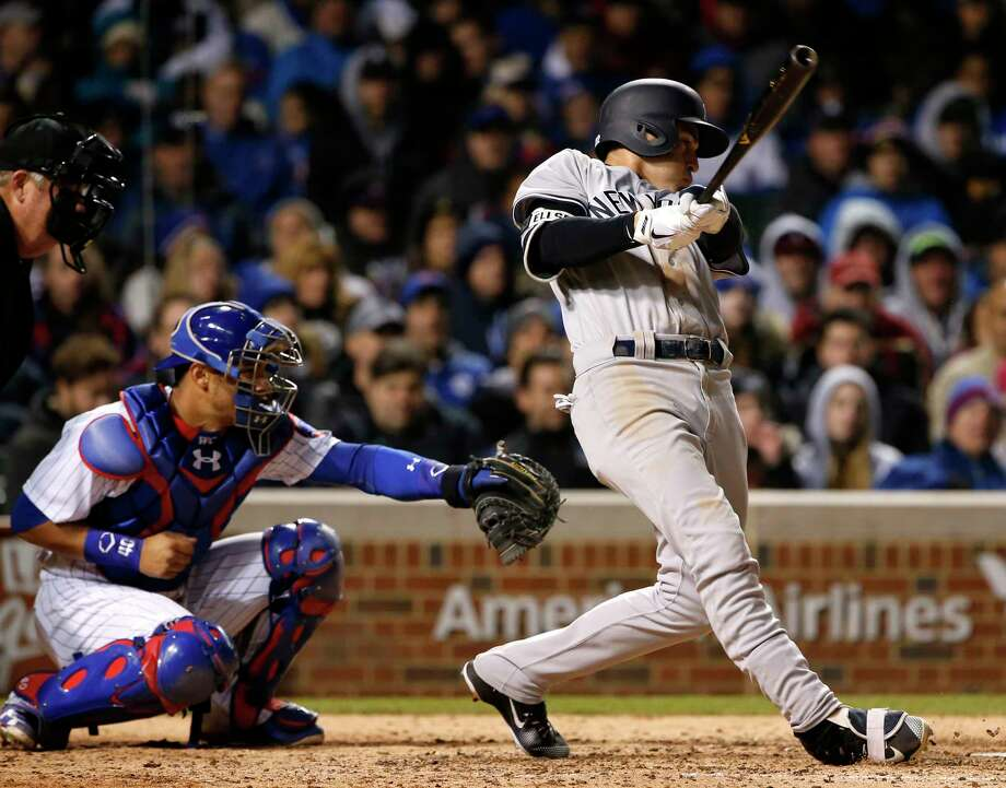 New York Yankees' Jacoby Ellsbury, right, hits a two-run home run against the Chicago Cubs during the eighth inning of an interleague baseball game Sunday, May 7, 2017 in Chicago. (AP Photo/Nam Y. Huh) ORG XMIT: CXC121 Photo: Nam Y. Huh / Copyright 2017 The Associated Press. All rights reserved.